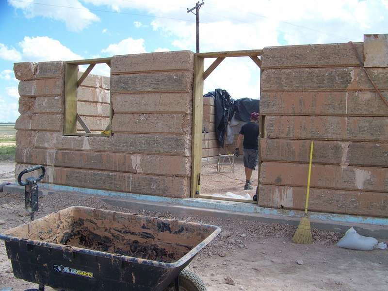 Low cost building methods compressed earth block for Adobe construction cost