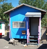 dignity village blue and pink house